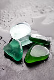 Wet glass pieces polished by the sea Royalty Free Stock Images