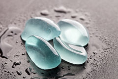 Wet glass pieces polished by the sea Stock Photos