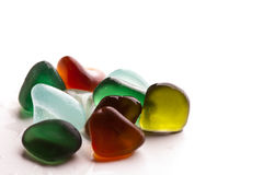 Wet glass pieces polished by the sea Royalty Free Stock Image
