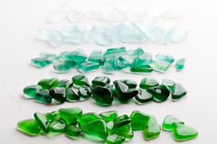 Wet glass pieces polished by the sea Stock Image