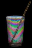 Wet glass with straws (cross-polarised) Royalty Free Stock Photo