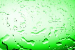 Wet glass surface in drops of water, green gradient, illustration of cood or cold bottle of beer or drink, spilled water texture stock photos
