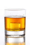 Wet glass with whiskey inside Royalty Free Stock Image