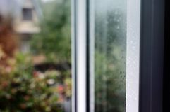 Wet glass of window backgrounds. Wet glass of window of country house, view countryside from indoors royalty free stock photography