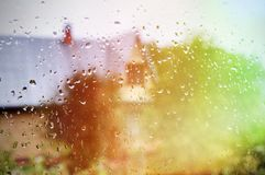 Wet glass of window backgrounds. Wet glass of window of country house, view countryside from indoors stock photography