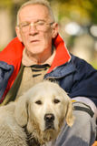 Wet Golden retriever in front of his master Stock Photography