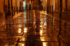 Wet golden street Royalty Free Stock Photos