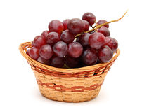 Wet grape berry bunch in basket Stock Photos