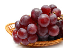Wet grape berry bunch in basket Royalty Free Stock Image