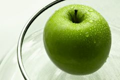 Wet green apple Stock Image