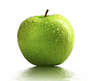 Wet green apple. Close up image of green apple with water drop on the skin Stock Images