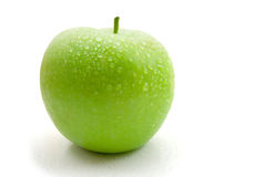 Wet green apple. Wet apple isolated on the white background royalty free stock photography