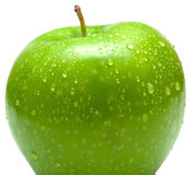 Wet green apple. Covered by water drops on white background. Isolation royalty free stock photography