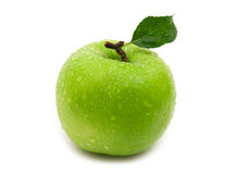 Wet green apple. On white background royalty free stock photo