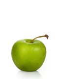 Wet green apple on a white background Stock Images