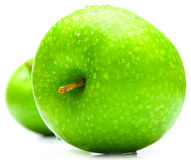 Wet green apples. The wet green apples covered by drops of water. Isolation on white, shallow DOF Royalty Free Stock Images