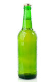 Wet green beer bottle Stock Photos