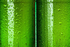Wet green beer bottles abstract Royalty Free Stock Photos
