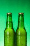 Wet green beer bottles Stock Photography