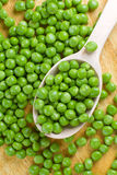 Wet green peas Stock Photography