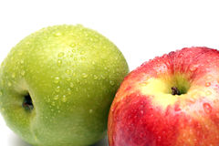 Wet green and red apple fruits. With water drops close-up royalty free stock image