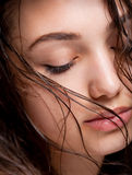 Wet hair beauty. Portrait of gorgeous young brunette woman with wet hair Royalty Free Stock Photography