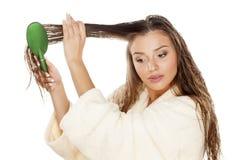 Wet hair combing Stock Image