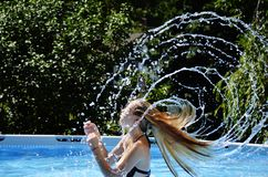 Wet hair flipping Royalty Free Stock Image