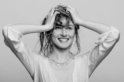 Wet hair headshot portrait, of a happy, smiling model girl, woman, lady Royalty Free Stock Images