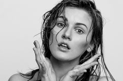 Wet hair headshot portrait, of a surprised model girl, woman, lady Stock Image
