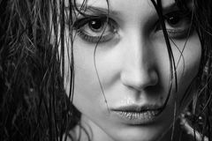 Wet hair portrait. Beautiful woman with wet hair looking at camera, monochrome image Royalty Free Stock Photo