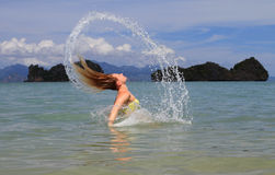 Wet hair. Water splashes with some blur Royalty Free Stock Image
