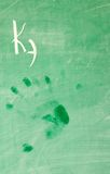 Wet hand-print on school-board royalty free stock photo