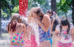 Wet and happy kids in a splash pad. August 2017 south bend IN USA; kids happily play in the splash pad at  Potawatomi Park Royalty Free Stock Photos
