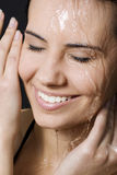Wet and happy woman Stock Images