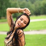 Wet  happy woman walking in the rain Stock Photography