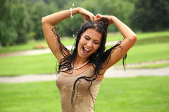 Wet  happy woman walking in the rain Royalty Free Stock Photos