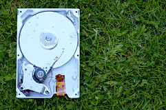 Wet hard disk. Hard disk wet on the grass royalty free stock photos