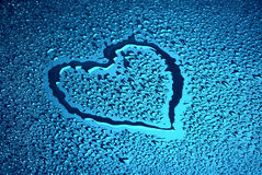 Wet heart. Heart on blue wet surface Stock Image