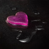 Wet heart on a velvet Stock Image