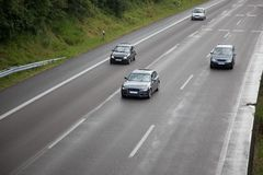 Wet highway with cars Stock Photo