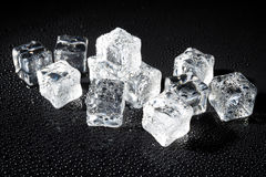 Wet ice cubes on black background Royalty Free Stock Photography
