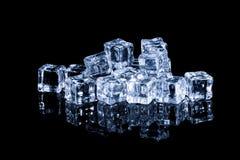 Wet ice cubes on black background Stock Image