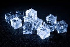 Wet ice cubes on black background Stock Photos