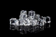 Wet ice cubes on black background Royalty Free Stock Photos