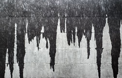 Wet icicles on facade wall creating abstract gray background texture Royalty Free Stock Photos