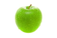 Wet juicy green apple. Isolated on white background royalty free stock image