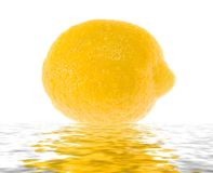 Wet juicy lemon in water. Royalty Free Stock Photos
