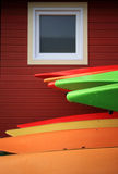 Wet Kayaks Below Window Royalty Free Stock Photography