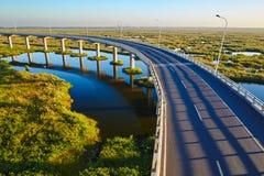 The wet land bridge sunset Stock Photo